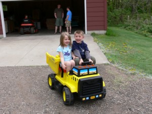 Ben and Grace riding in GABE\'S toy!